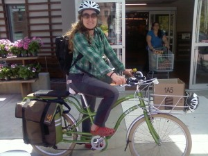 Erin Maile O'Keefe at the Brattleboro Coopon on her Yuba Boda Boda mid-tail bike with electric-assist.