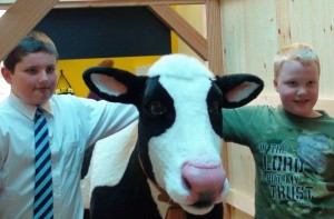 1.Jared McGee, a student at West Rutland Elementary School, and Dillon Brigham, a student at Danville School, both named EIC's cow for their exhibit. Photo courtesy of Green Mountain Power.