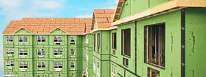 This image of a multi family housing with green sheathings depicts a good air barrier.