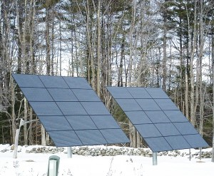 New Hampshire winter scene with solar PVs and an old stone wall. Photos by Kim Frase.