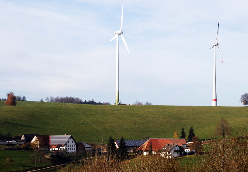 The village of Freiamt, Germany, with its 4,300 inhabitants, is using a mix of renewable energy -- a biogas plant, solar, wind and water -- to produce more than 100% of their energy needs. Pictured is the Schneider family farm – dairy cows, schnapps making, 100kW of solar PV and two wind turbines.