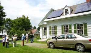 A Solar Source crew installs a three-kilowatt solar PV system at the home of Solarize Cornish-Plainfield volunteer Nancy Wightman.