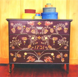 An early Taunton milk-painted chest that Charles Thibeau made and daughter Anne painted in the late '70s or early '80s. Courtesy of Old Fashioned Milk Paint Co.