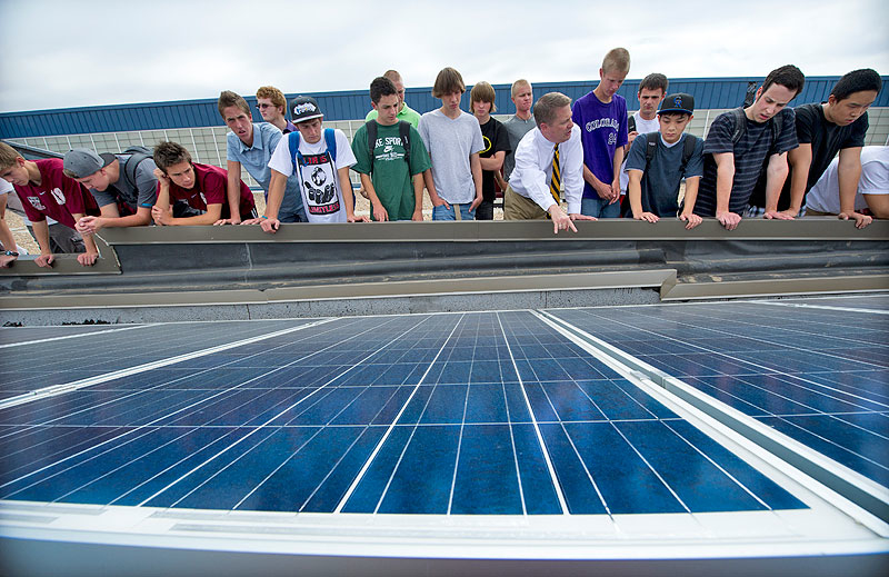 "NREL sponsored the ""Solar on Schools"" program that was adopted by Jeffco Public Schools, the largest district in Colorado. Chatfield High School students learn about photovoltaics on the school's roof. Credit: Dennis Schroeder"