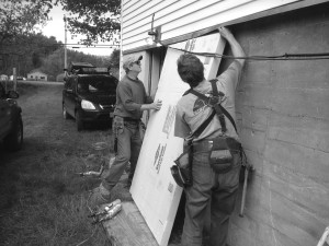 Installing foam on a foundation wall