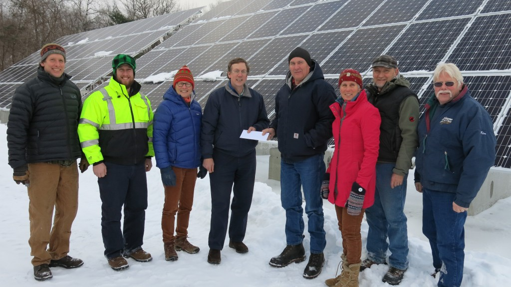 Key players in the group that contributed to the construction of the PVWSD solar array met recently to receive a project incentive check from NHEC. From left: Larry Mauchly of Mauchly Electric, PVWSD Superintendent Jason Randall, Interim PVWSD Administrator Merelise O'Connor, PVWSD Commissioner Chris Woods, NHEC Program Administrator Scott C. McNeil, PAREI Director Sandra Jones, PAREI Solar Crew Member Tim Gotwols, Kim Frase of Frase Electric.