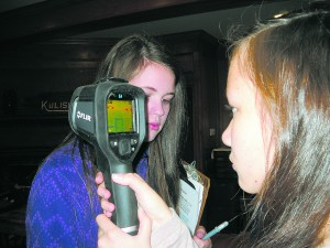 1. Shalie Alfonso and Emma Simila of Peterborough conduct an energy audit at the Harris Center.