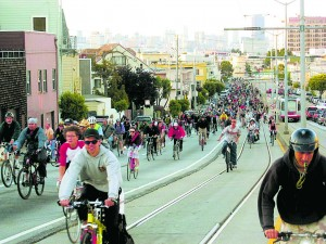 Critical Mass biking event in San Francisco. This event takes place in hundreds of cities worldwide, each month. Photo by mwparenteau, from Wikimedia Commons.
