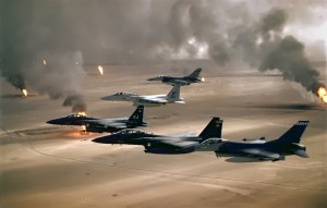 US aircraft fly above oil fields set on fire by Saddam Hussein's forces in Desert Storm, commonly referred to as an oil war. US Air Force photo. Public Domain.