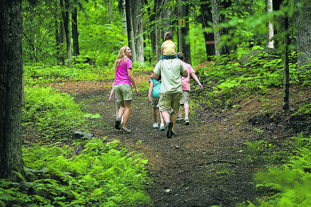 A family hiking at Smugglers' Notch Resort. Photo courtesy of Stowe Resort