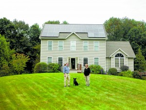 The Roberts family are happy about their choice to go solar with net metering benefits. The future of net metered solar in NH is jeopardy. Photo courtesy of ReVision Energy.