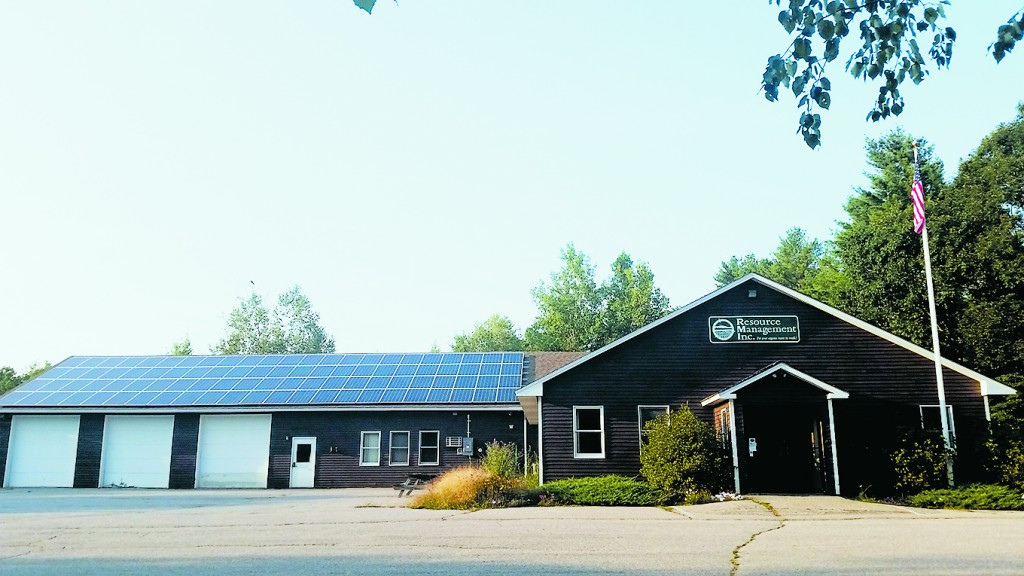 The ninety-two 260-watt PV panels on RMI's roof are expected to produce 27,000 kWh of electricity each year -- about 100% of their annual electric use. Photo courtesy of Resource Management, Inc.