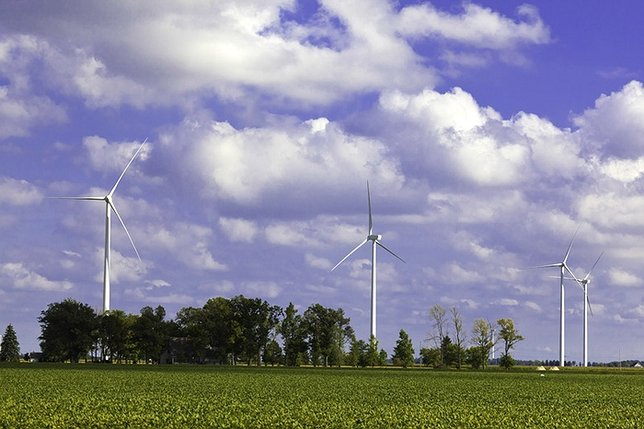 Wind turbines producing enough energy can help reduce carbon pollution. Photo by: Wind Energy Foundation on Facebook.