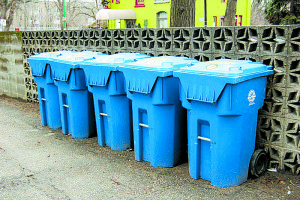 Recycling companies are struggling with higher processing costs, due in part to newer, larger recycling bins that don't require user sorting and thus become increasingly contaminated with garbage. Credit: Dan McKay, FlickrCC