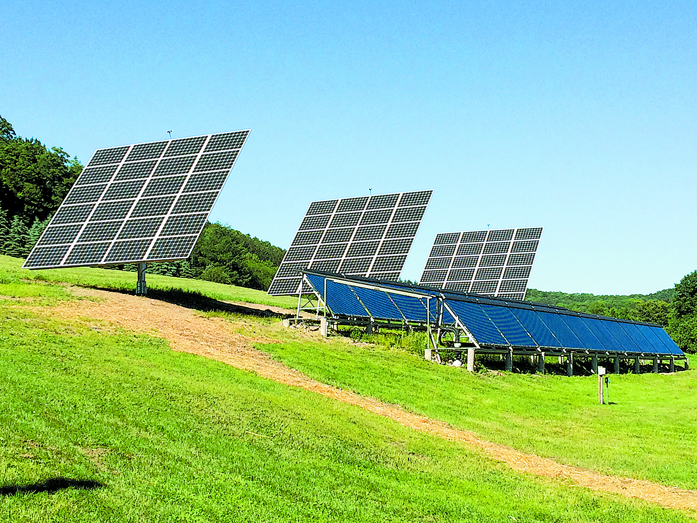 The PV solar tracking system sits above the solar thermal evacuated tube arrays. Courtesy photos.