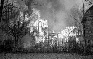 Structures are seen burning in No. Blenheim, NY on March 13, 1990.