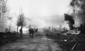 FireFighters survey the damage on Rt. 30 in No. Blenheim, NY as buildings continue to smolder on Mach 13, 1990.