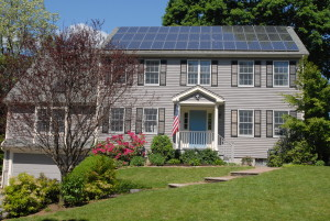 Solar PV on the roof of a house near Boston, MA. Photo by Gray Watson, Wikimedia.