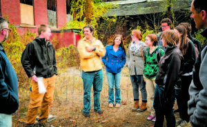 Silas Miller from Credere Associate discusses the Phase 1 brownfield site assessment for the Stanley Mill Building in Franklin, N.H. with students from the Community-Based Research Project class.
