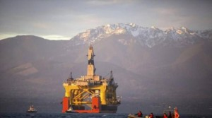 An oil drilling rig as it arrived in Port Angeles, Wash. in 2015 aboard a transport ship bound for exploratory drilling in the Chukchi Sea off Alaska's northwest coast. (Daniella Beccaria / AP)
