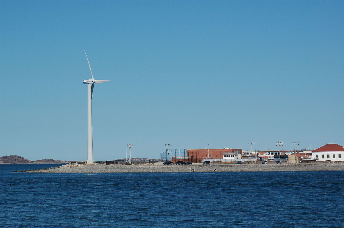 Wind turbine in Hull, Massachusetts. Photo by Fish Cop, placed in the public domain by the author. Wikimedia Commons.