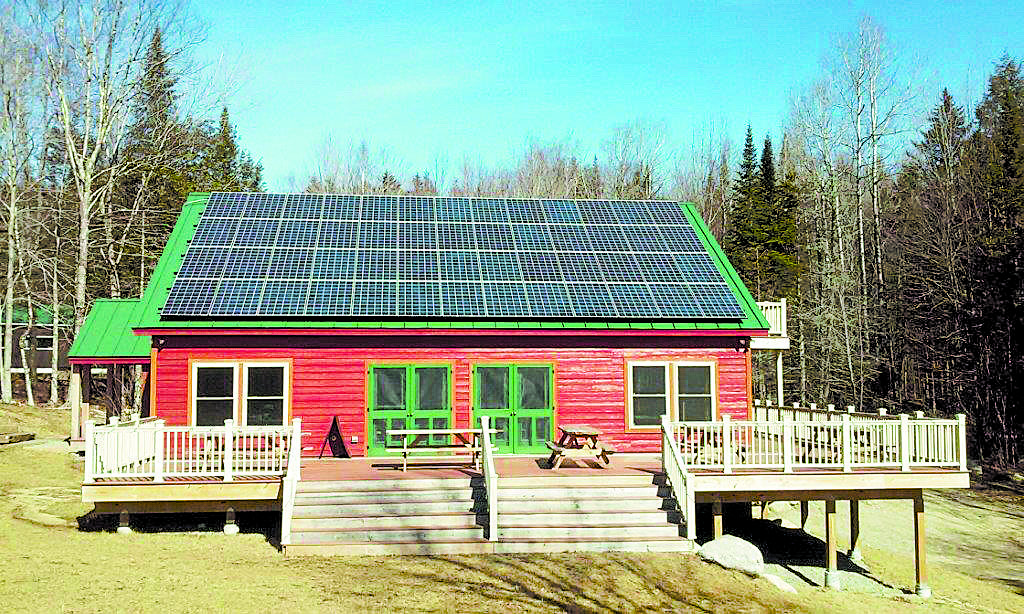 A 13.52 kW of solar on Copper Cannon Camp's dining hall in Bethlehem, NH will reduce its carbon dioxide emissions by over 14,000 pounds annually. Photo: Revision Energy