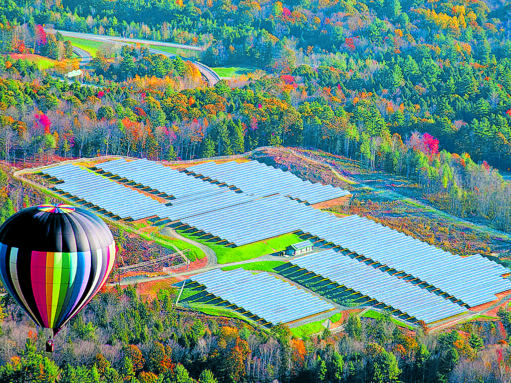 Utility-scale solar system in Vermont. These systems do not usually come with hot air balloons. Photo courtesy of RBI Solar.