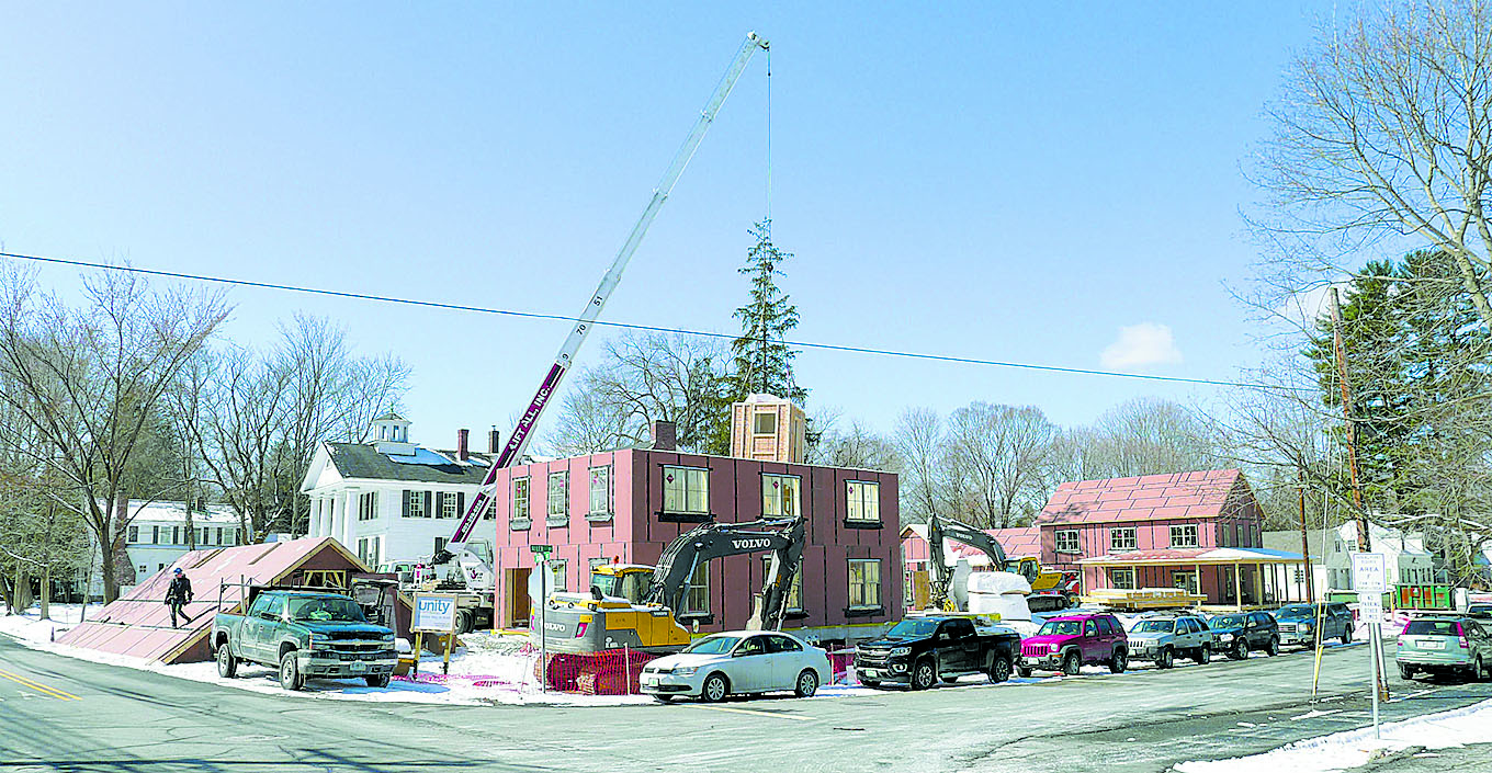 Bath Pod being lowered into place with pre-fabricated roof adjacent and ready to install into one of the four hi-performance homes that are being built for Dartmouth faculty and students -- Hanover, N H.