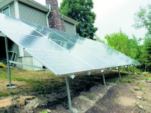 Self-installed, twenty-eight panel ground mount array. Photo courtesy of the Harrison Family.