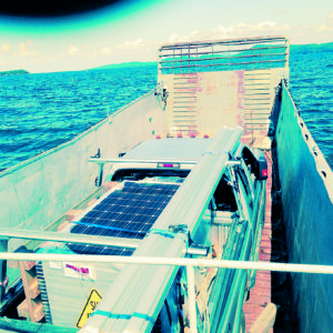 Transporting a palette of American-made SolarWorld SW285 solar panels and racking to an off-grid installation on an island in Lake Champlain. It was a great trip on the Korean War-era mechanized transport ship that now moves goods from shoreline to islands in the lake.