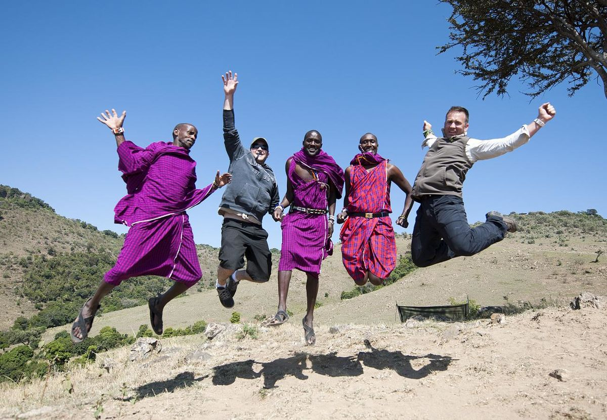 Maasai men and tourists jumping (Photo by Christopher Michel, CC BY SA, Wikimedia Commons)