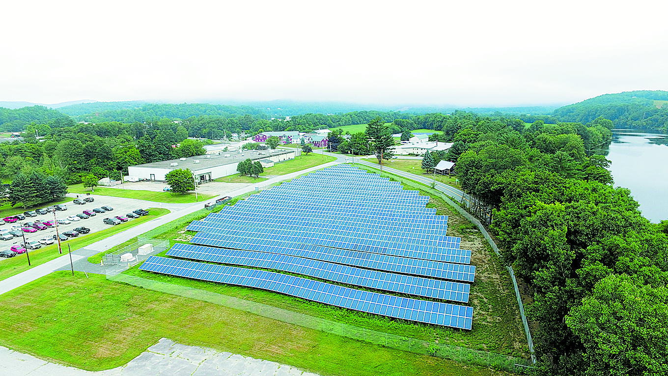 The 500kW solar installation is meeting expectations for Copeland Furniture's manufacturing plant in Bradford, VT. Catamount Solar installed the system. The plant is seen in the upper left corner. Photo: Isaac Copeland.