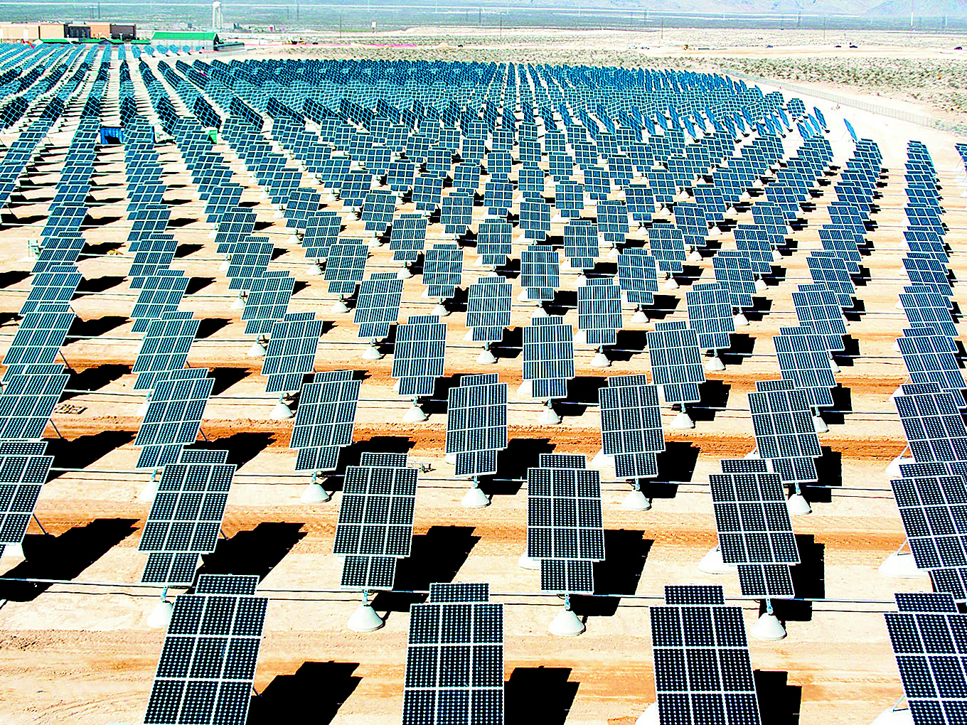 Nellis Solar Power Plant located at Nellis Air Force Base, northeast of Las Vegas. The power plant occupies 140 acres, contains about 70,000 solar panels and generates 14 megawatts of solar power for the base. Photo: Wikimedia Commons