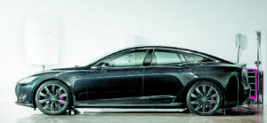 Courtesy photo of the Tesla Model S with Powerwall shown