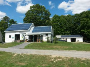 The solar array at pick-your-own Riverview Farm in Plainfield, NH powers the farm buildings as well as an electric vehicle charging station available to customers. Photo by Jonathan Teller-Elsberg. CC BY-SA.