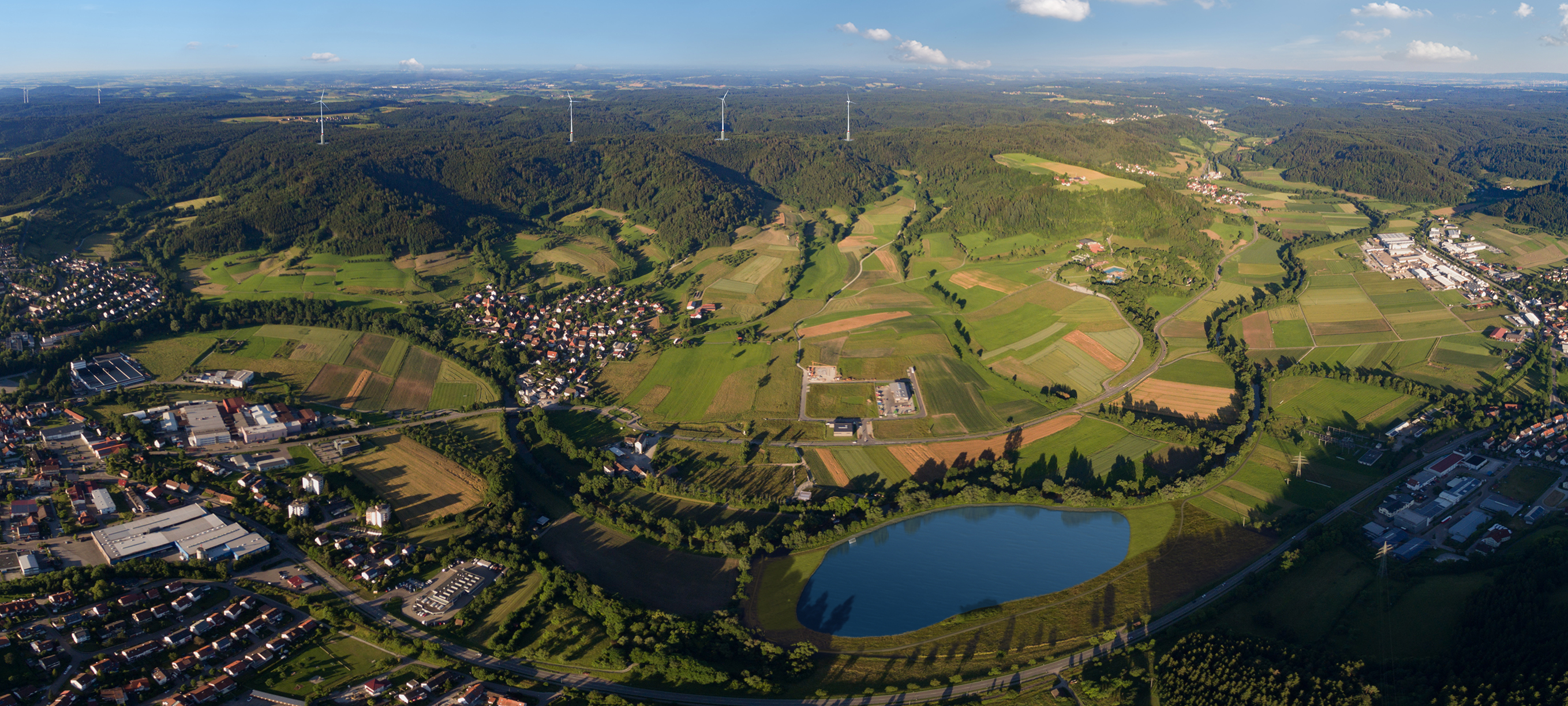 Aerial view of the Swabian-Franconian Forest in Germany, where the first wind farm with an integrated hydropower plant will be operational by the end of 2018. Photos - Copyright: Naturspeicher GmbH.