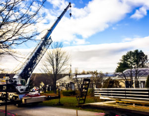 Norwich Technologies installing solar on the Maple Manor housing development in Newport, NH, using its proprietary EZ-PV MetaModule technology