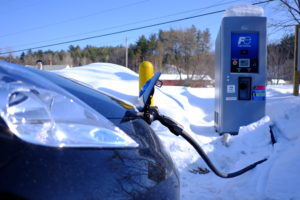 An all-electric Nissan LEAF receives a charge after a recent snowfall.