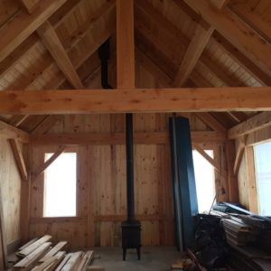 The interior of the Nansen Ski Club's new, energy-efficient warming hut . A small wood stove will help to keep visitors toasty warm after a day of skiing. Photo courtesy of ReVision Energy.