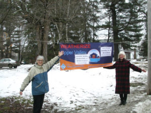 : Julia Lloyd Wright and Danny Bonta - hanging the banner for the Weathersfield area kick-of