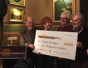 Dan Jones (left) and Deb Sachs present Team Bridges with a $10k check as the winners of the Net-Zero MP 2030 competition. Courtesy images