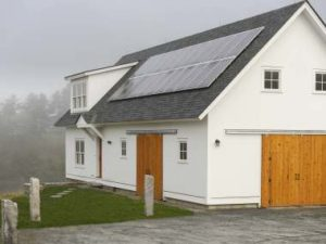 The RiverHouse. Exteriorview showssolar photovoltaic system on thebarn roof