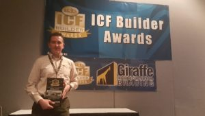 Andy Ellis receives ICF Builder Award for Best in Show in the Large Residential division at the World of Concrete Trade Show in Las Vegas on January 19, 2017. Photo courtesy Peter Ellis.