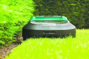 Robomow RS cutting the edge of a lawn. Photo: Robomow