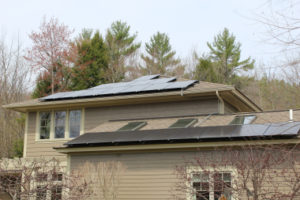 John Schumacher, Hanover, NH; 5.5 kW DC; 6,900 kWh/year; offsetting 142 tons of CO2.