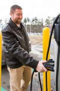 Harrison Williams, a BAE Systems employee uses the EV charging station at the company's South Nashua, New Hampshire location. Courtesy of BAE Systems' Electronic Systems
