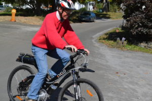 Tim Maker of Calais tries an e-bike at an electric vehicle demo last year. Courtesy photo