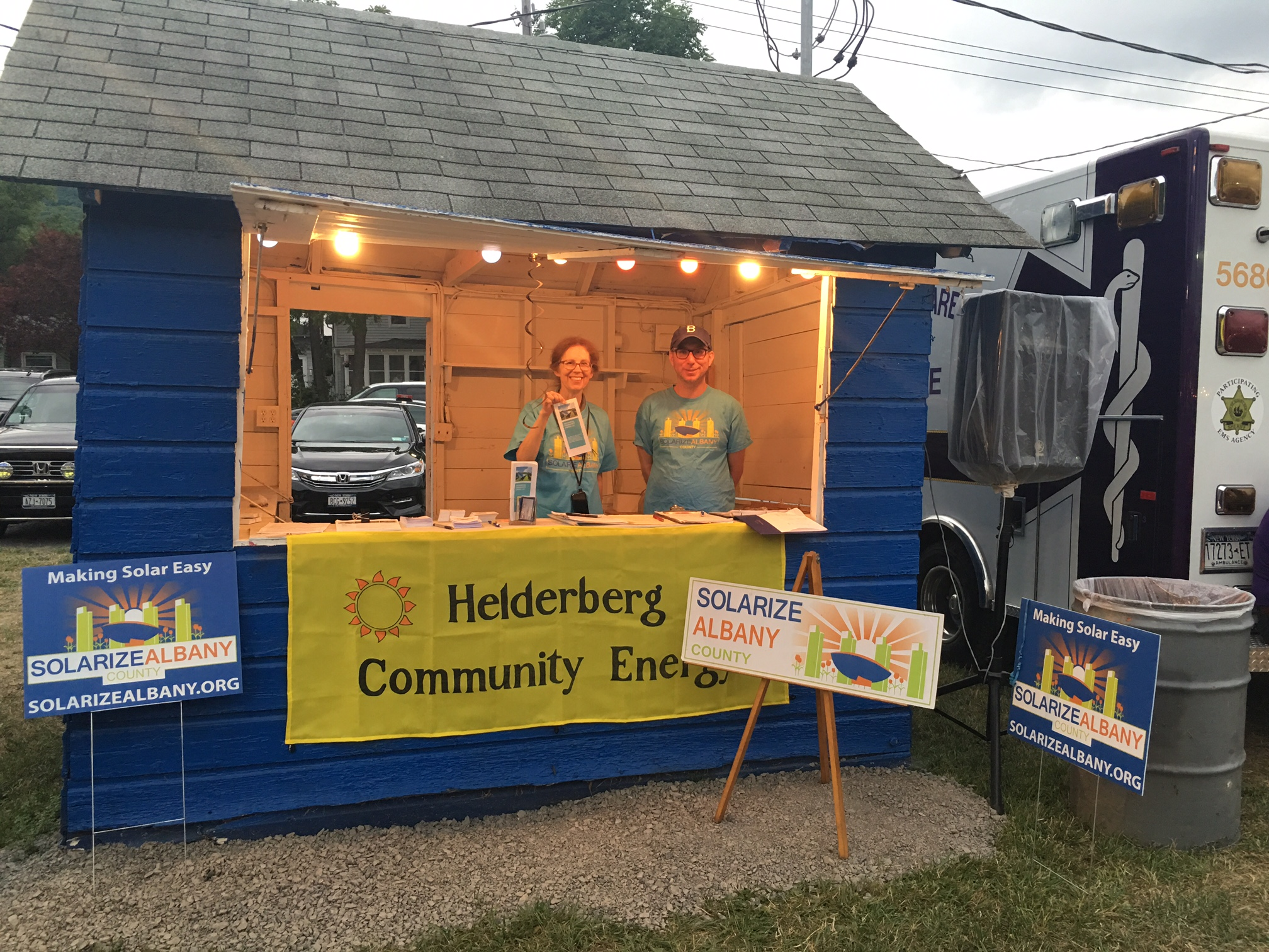 Amy Pokorny and Kevin Johnson educate attendees on the Solarize Albany program at the Punkintown Fair. Photo courtesy Russ Pokorny