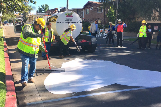 Painting LA's streets white (Twitter | LA Street Services)