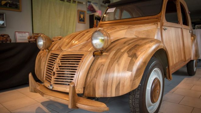 Replica Citroen 2CV crafted out of fruitwood (Getty Images)